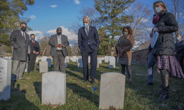 IMAGE: VA Secretary Denis McDonough receiving an overview of the Alexandria National Cemetery from NCA Historian, Ms. Jennifer Perunko
