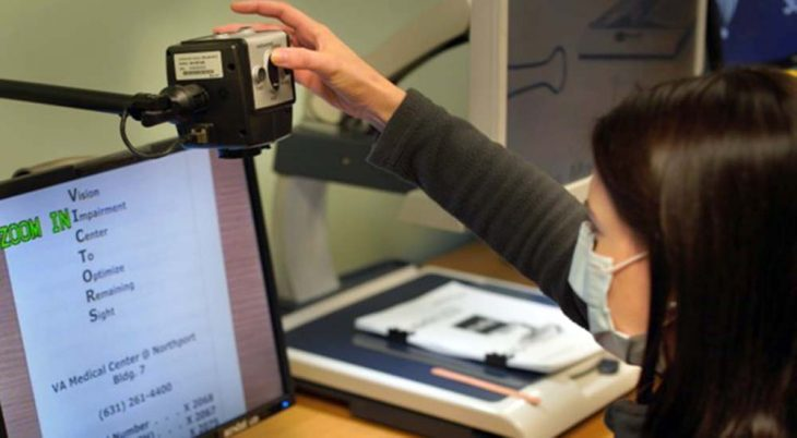 Doctor operates a camera for the visually impaired