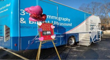 Large mammography bus with welcoming balloons