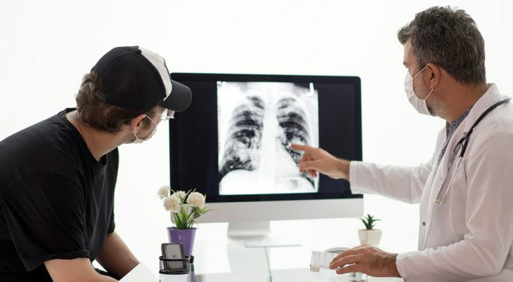Doctor and patient view lung x-ray