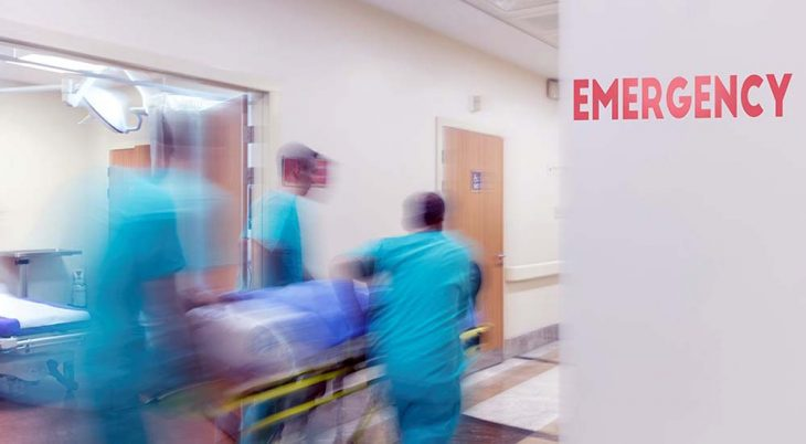 Medical staff rushing with a patient on a cart