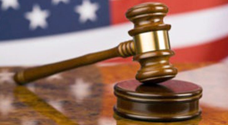 Court gavel with American flag in the background