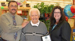 Elderly Veteran presented certificate of appreciation