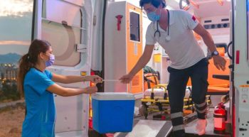 EMT hands nurse a kidney in a cooler