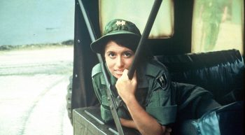 Female nurse in uniform in Army jeep