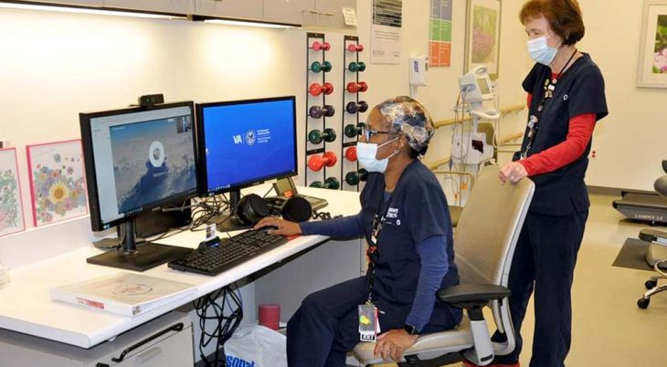 Two therapists conducting therapy session via remote monitor