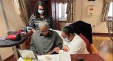 Elderly Veteran comforted by nursing home staff