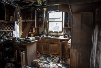 Image of charred kitchen after a home fire.