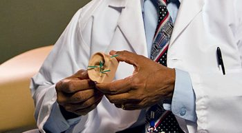 Doctor showing an example of an auricular slant.