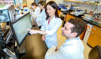 In their lab at the Atlanta VA and Emory University, Dr. Thomas Wingo and Dr. Aliza Wingo (foreground) have found genes and corresponding proteins that could open doors for new depression treatments.
