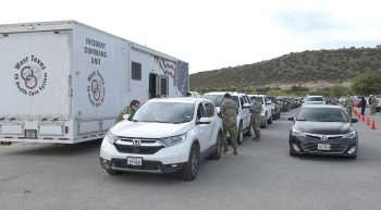 Cars lined up next to VA Mobile Unit to receive vaccine