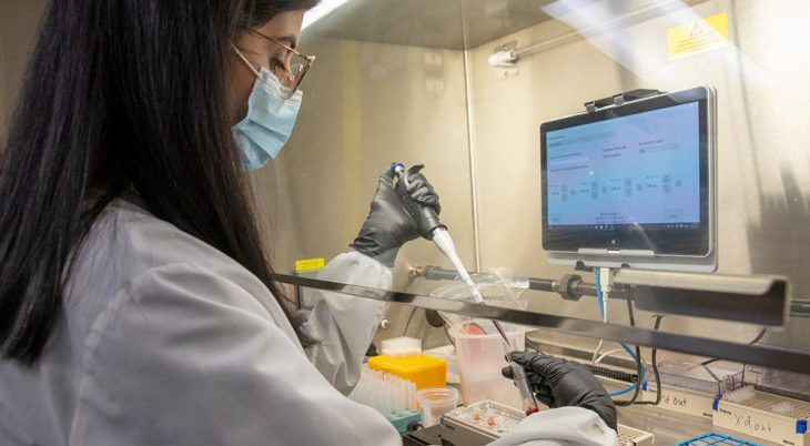 Woman conducts genetic research