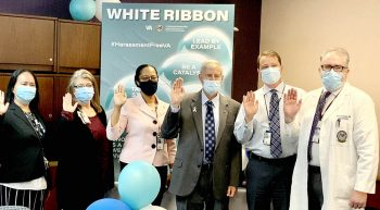 Six hospital executives raise hands to take pledge