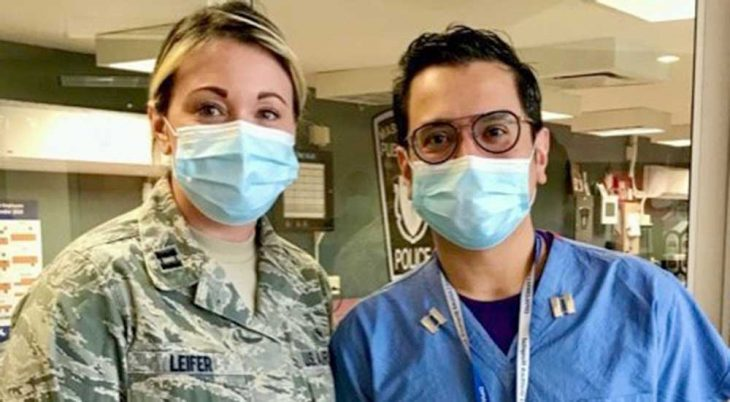 Female soldier and male nurse in masks