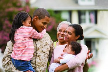 Marine family embraces.
