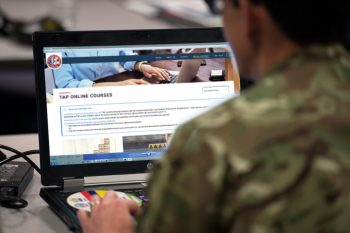 Soldier using TAP on a laptop.