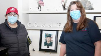 Two women with photo of soldier