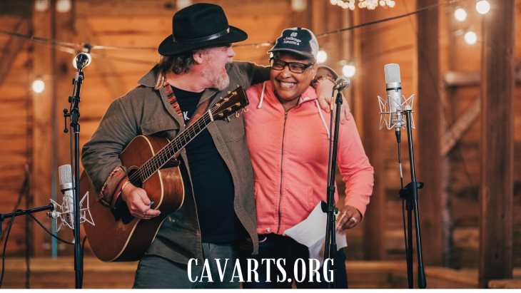 two veterans singing on stage