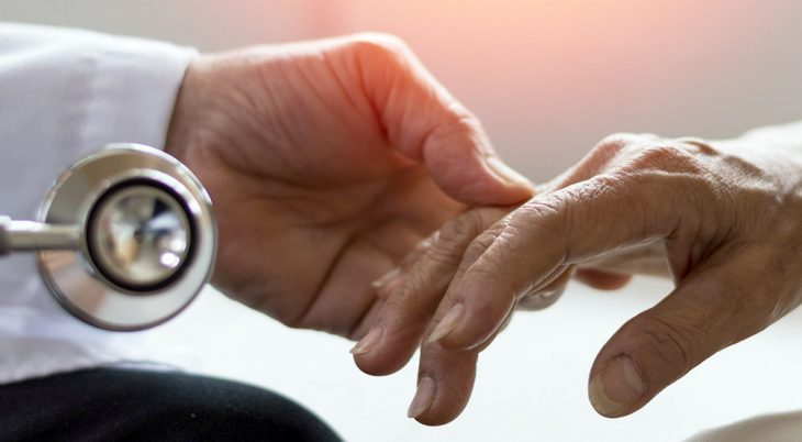 Doctor's hand holding hand of patient