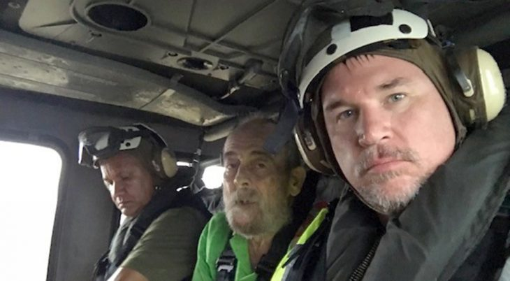 Three men in a Navy helicopter