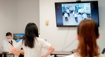 Participants join exercise program on TV monitor