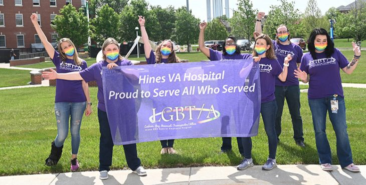Staff members at Hines VA Medical Center show their support for LGBT and Related Identities Veterans.