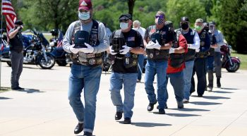 Line of men carrying remains of deceased