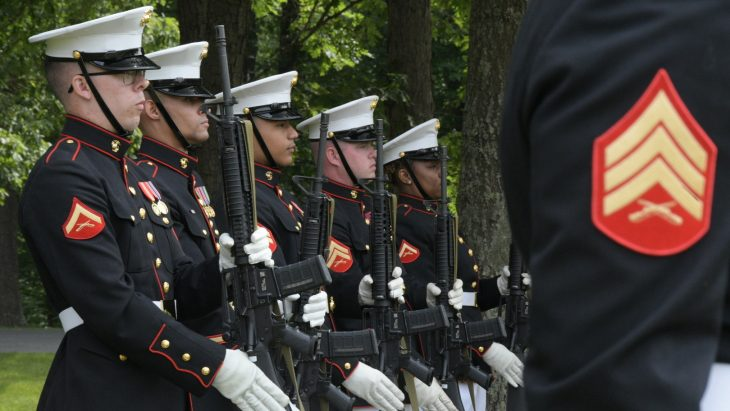 Marines from Marine Corps Base Quantico prepare for a 21-gun salute during the May 28, 2021, Memorial Day observance at Quantico National Cemetery.