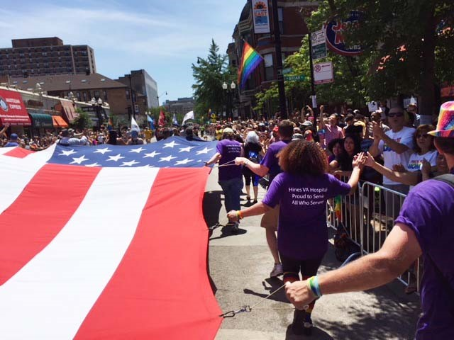 People walk in a pride parade in Illinois.