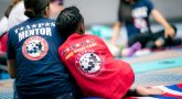 TAPS Military Mentor Supporting a Surviving Child during a TAPS Good Grief Camp