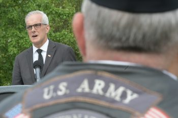 VA Secretary Denis McDonough speaks at a Memorial Day observance at Quantico National Cemetery in Virginia May 28, 2021.