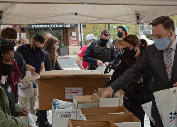 Volunteers from Operation Gratitude, Blue Star Families and Starbucks pack boxes to send to troops.