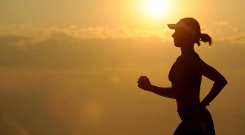 Silhouette of woman jogging
