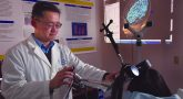 Doctor performing repetitive transcranial magnetic stimulation