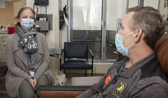 Dr. Julie Graff, an oncologist at the Portland VA, consults with Army Veteran David Atkinson, whose aggressive prostate cancer was treated based on genetic testing.