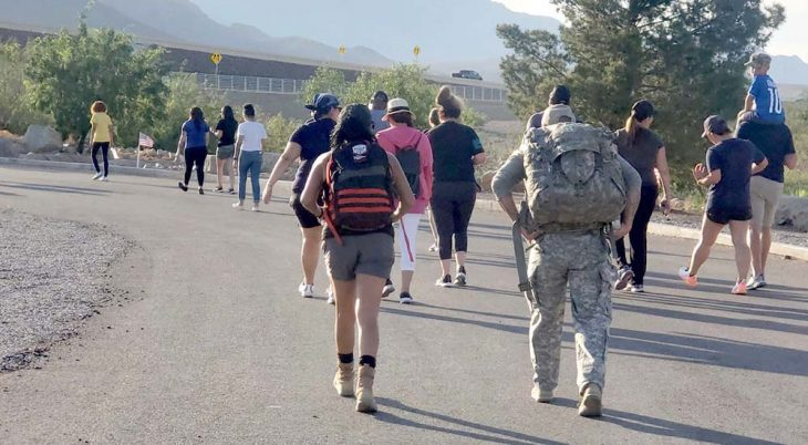 Group of people walking on road for National PTSD Awareness Day