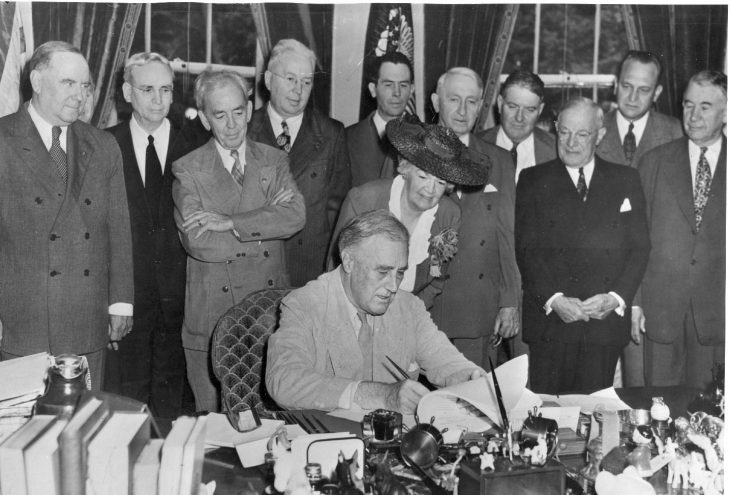 President Franklin D. Roosevelt signs the GI Bill of Rights at the White House, June 22, 1944. Courtesy photo