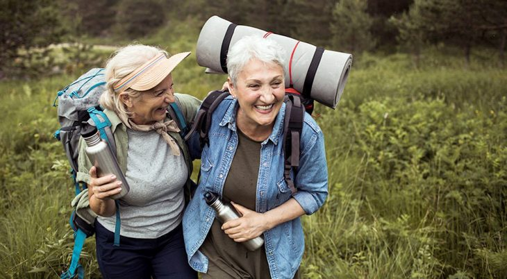 Two happy women on a hike