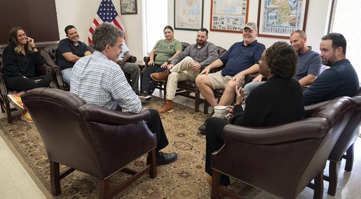 Ten Veterans in a group counseling session