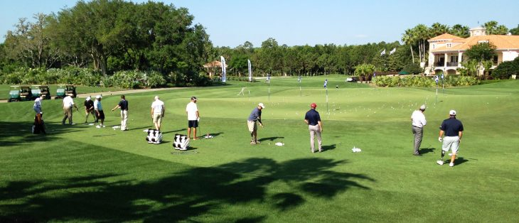 golfers at a driving range