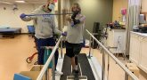 Veteran and therapist working out on treadmill