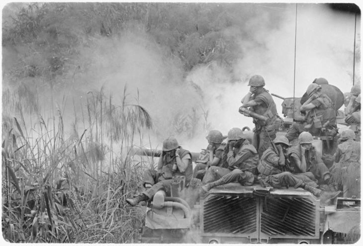 A new analysis of data from the Vietnam era found that LGB Veterans who served at the time are reporting PTSD and poorer mental health more often than their heterosexual counterparts. Here, Marines ride atop a tank during a road sweep near Phu Bai in central Vietnam.