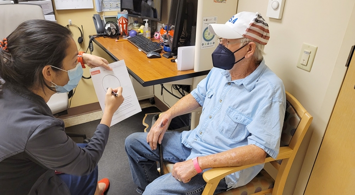 A doctor shares with a male patient his results from a cognitive screening