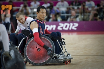 man in wheelchair on rugby court