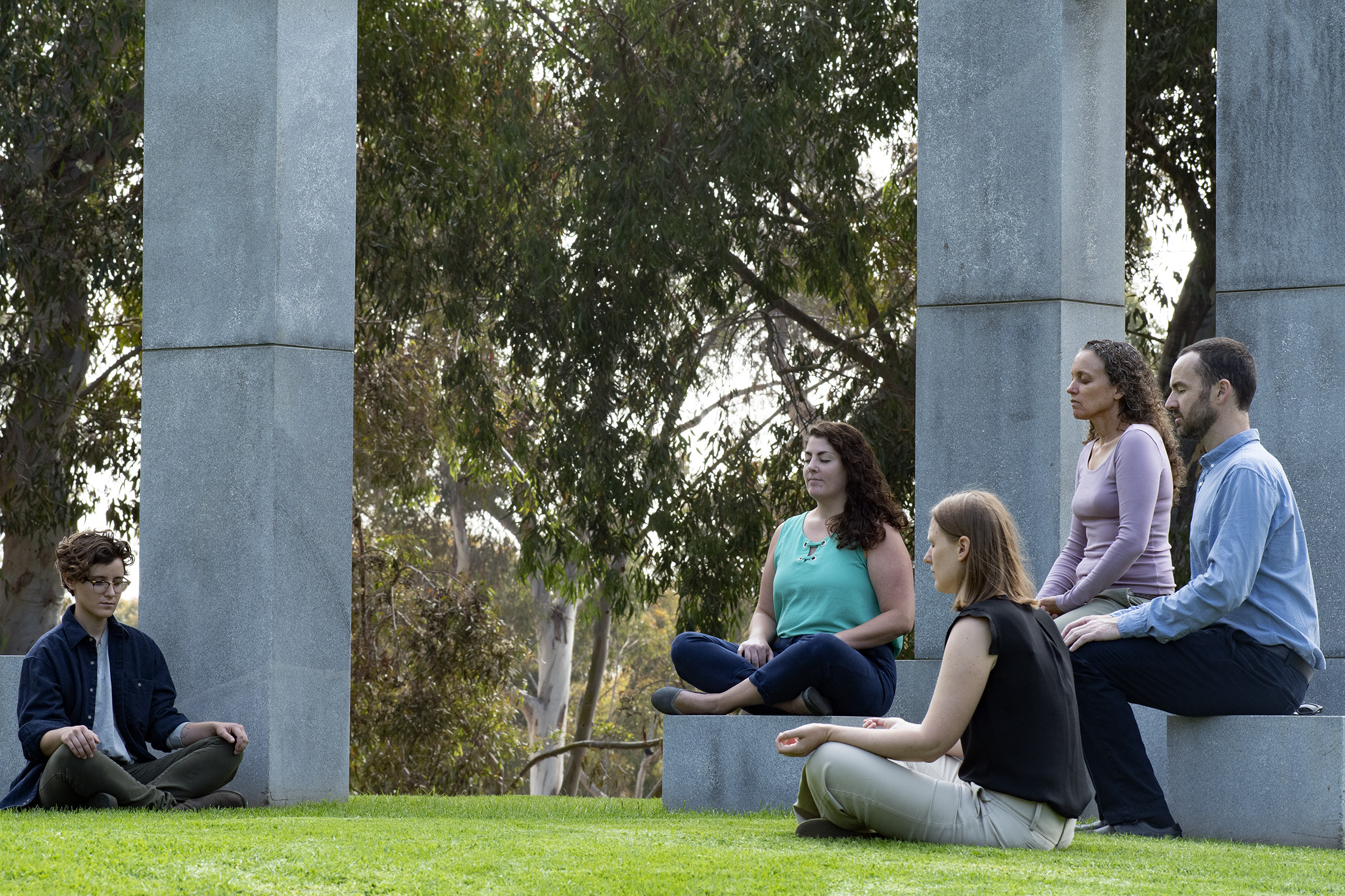 Dr. Ariel Lang (second from right) practices meditation with associates from her lab. She's focusing on complementary and alternative techniques, such as yoga and meditation, as a therapy for patients with PTSD.