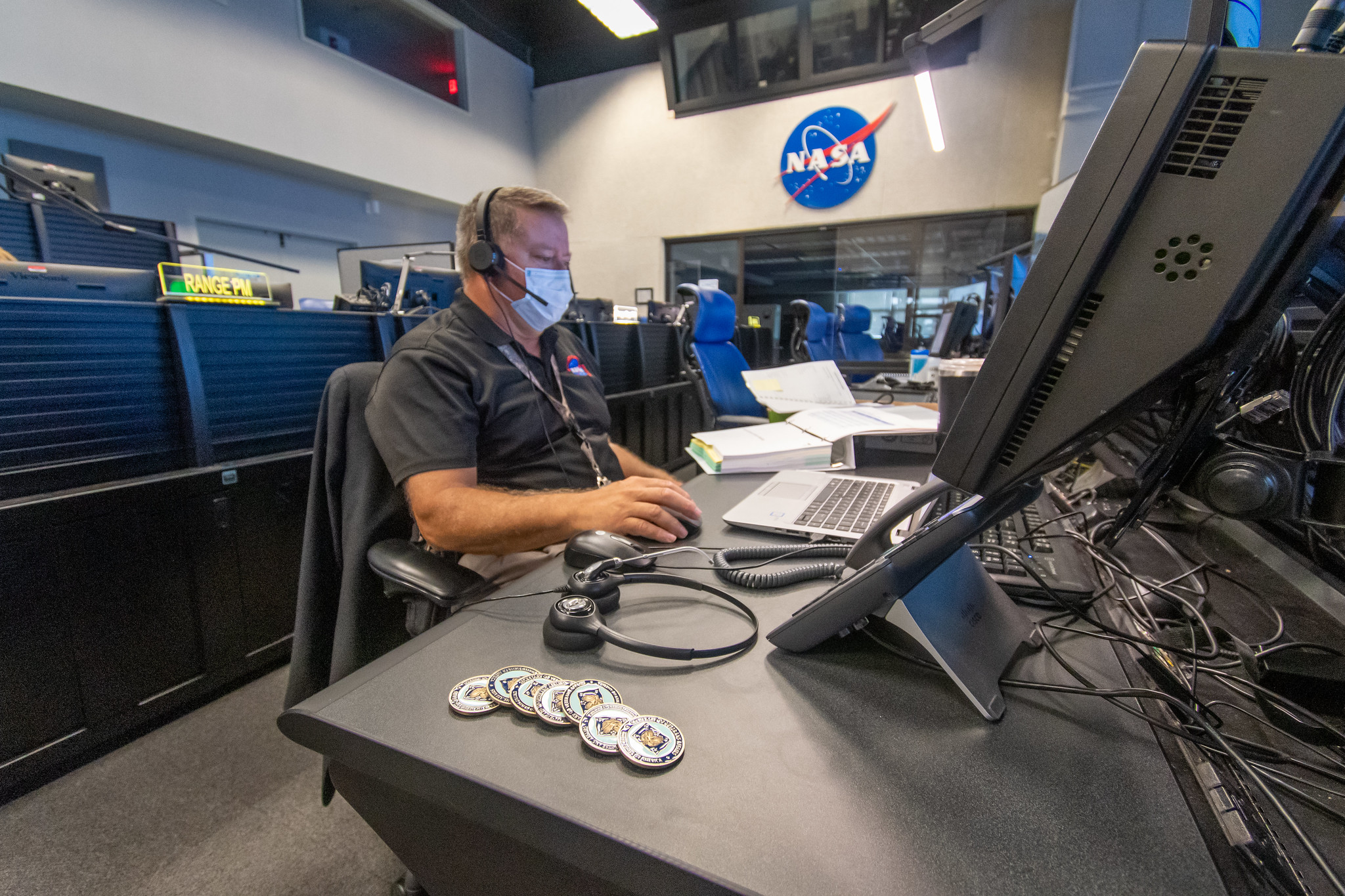 Greg Cusimano works at computer inside NASA's Range Control Center to help resupply the International Space Station
