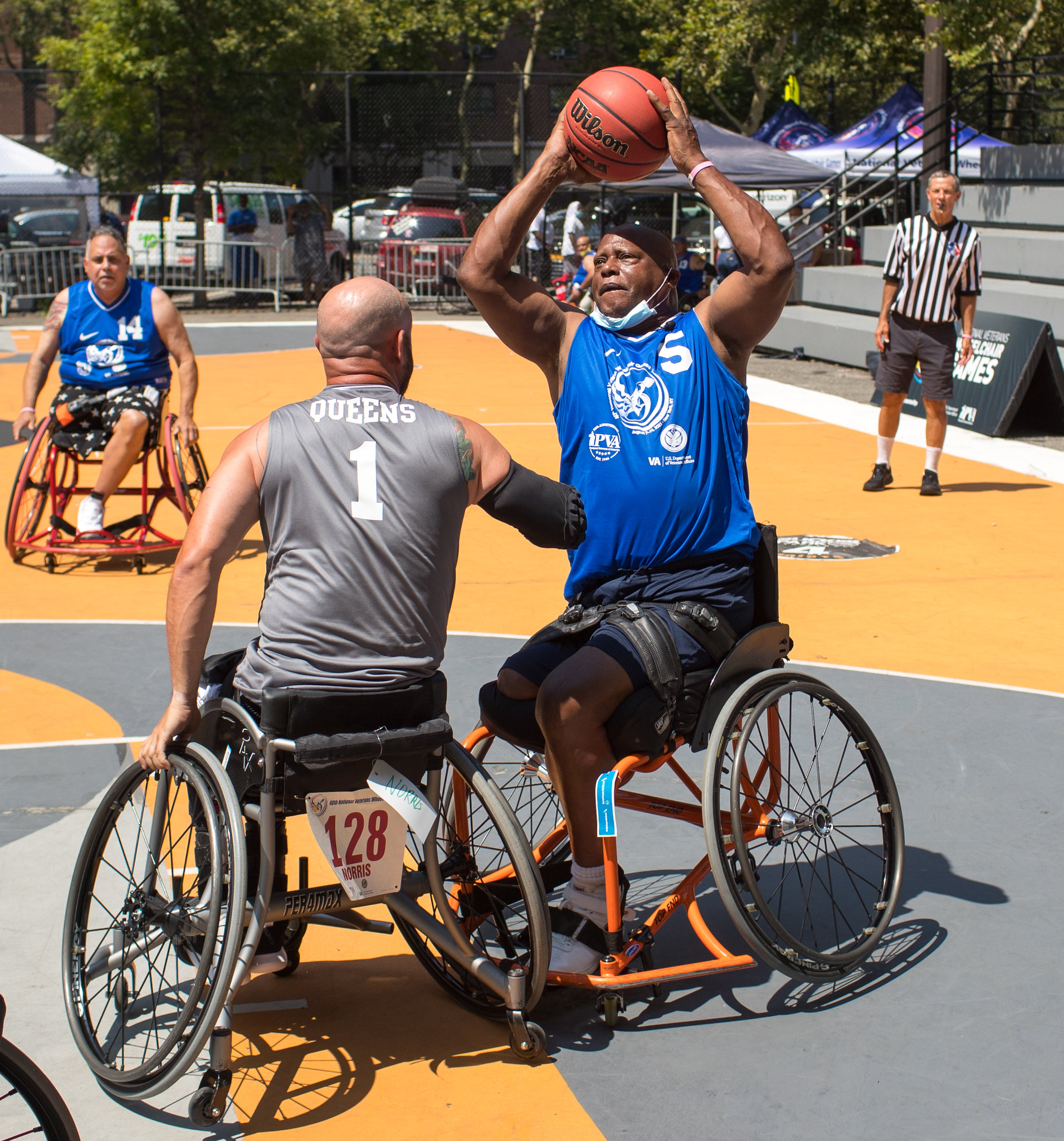 Army Veteran Roy Wilkins (5), a former college basketball player, won a bronze medal in basketball at the 40th National Veterans Wheelchair Games.