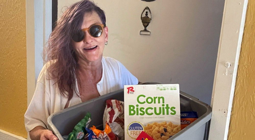 Woman with a box of food, insecurity