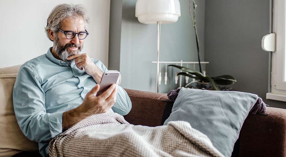 Man looks at his vaccine record on his phone