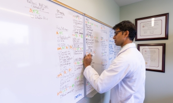 Dr. Ravi Parikh is a cancer doctor with expertise in informatics and health care delivery. Among other areas, he studies the use of health technology—such as artificial intelligence—to improve routine patient care. (Photo by Sam Shavers)